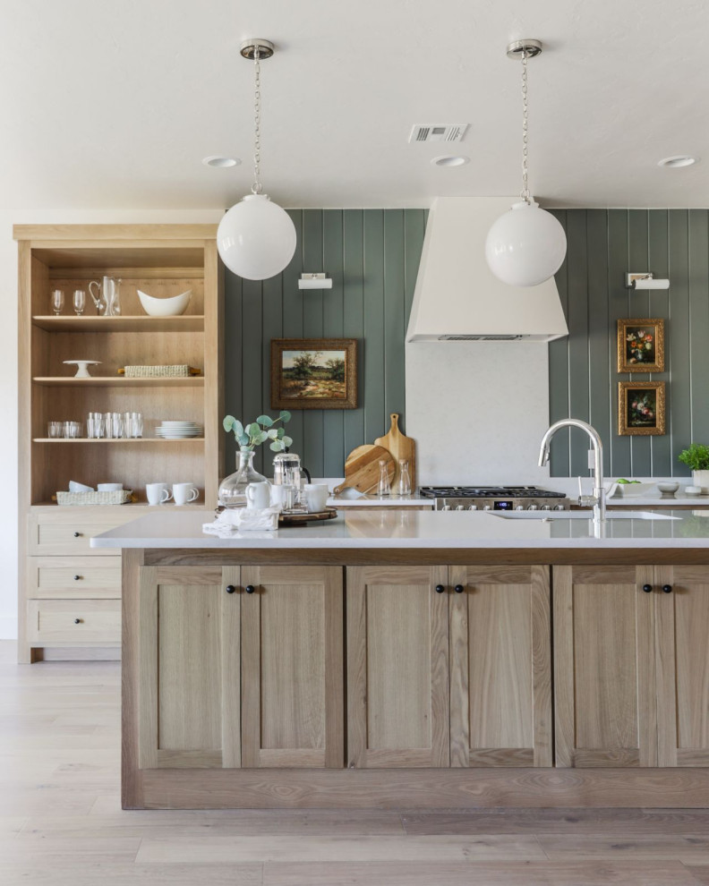 Mid-sized transitional l-shaped light wood floor and beige floor open concept kitchen photo in Oklahoma City with an undermount sink, shaker cabinets, light wood cabinets, quartz countertops, white backsplash, quartz backsplash, stainless steel appliances, an island and white countertops