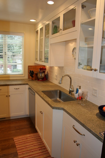 The bank of clear glass uppers draw attention away from the counter depth change traditional-kitchen