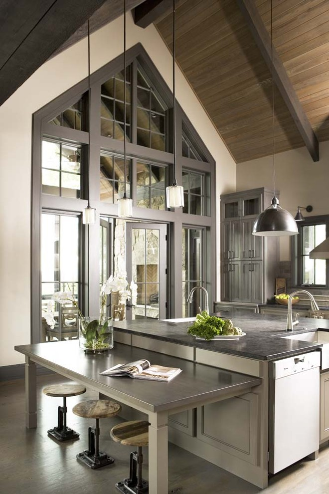 Example of a huge mountain style light wood floor eat-in kitchen design in Other with a farmhouse sink, stainless steel appliances and an island