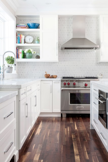 Large transitional l-shaped dark wood floor eat-in kitchen photo in Boston with white cabinets, white backsplash, stainless steel appliances, an undermount sink, recessed-panel cabinets, mosaic tile backsplash and an island