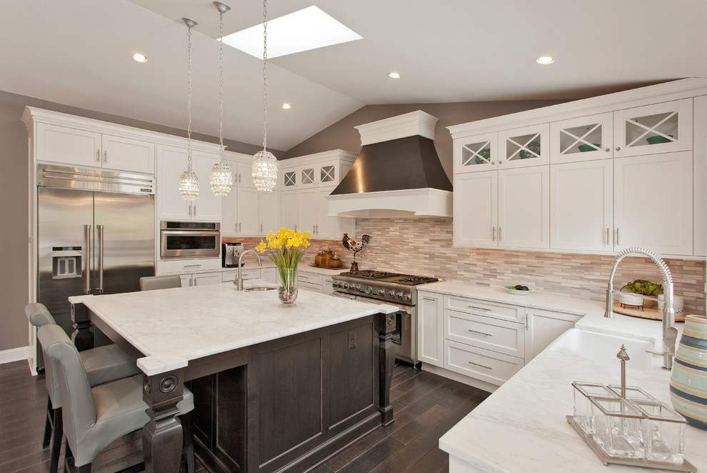 Kitchen - large contemporary u-shaped kitchen idea in DC Metro with shaker cabinets, white cabinets, marble countertops, stone tile backsplash, stainless steel appliances and an island
