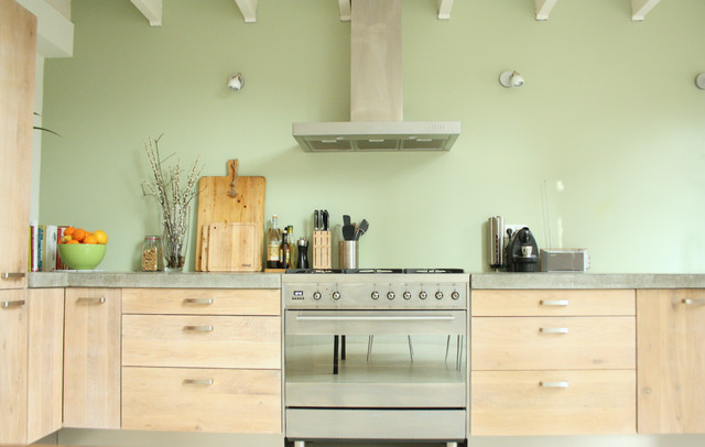 Inspiration For An Industrial Kitchen Remodel In Amsterdam With Flat Panel  Cabinets, Light Wood