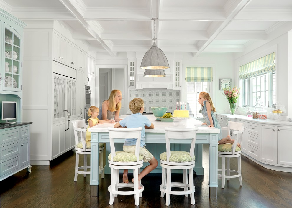 Kitchen - traditional kitchen idea in St Louis with glass-front cabinets and white countertops