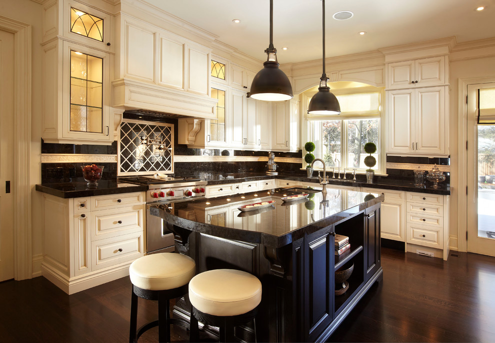 Example of a large classic u-shaped dark wood floor open concept kitchen design in Toronto with raised-panel cabinets, stainless steel appliances, an undermount sink, white cabinets, granite countertops, multicolored backsplash, an island and black countertops