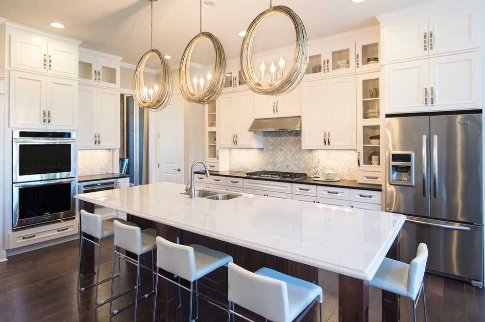 Example of a transitional dark wood floor kitchen design in Raleigh with a double-bowl sink, beaded inset cabinets, dark wood cabinets, gray backsplash, mosaic tile backsplash, stainless steel appliances and an island