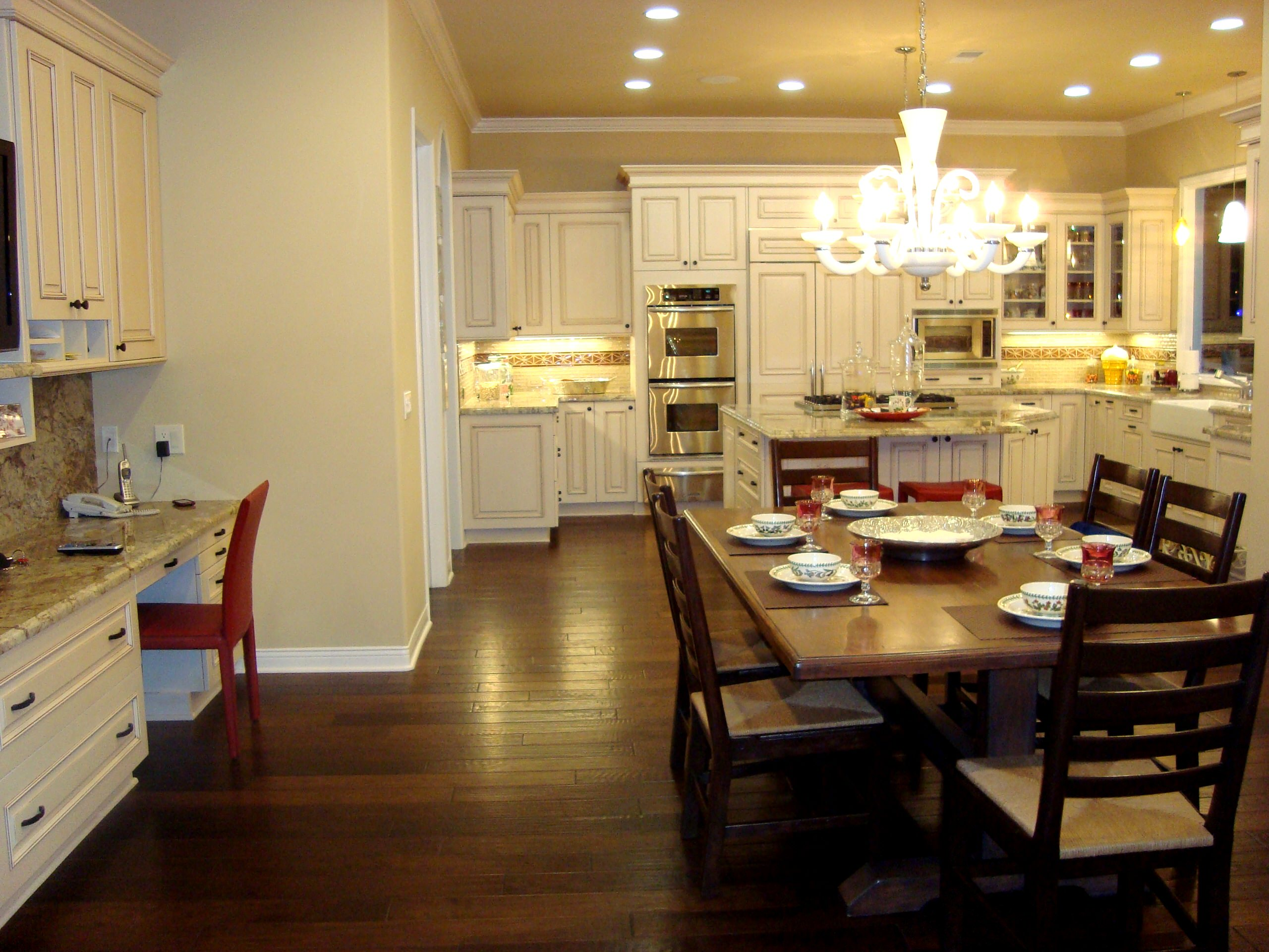 The Nolan Kitchen In Brookhaven Cabinetry, and adjacent desk/office area.