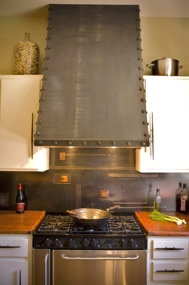 Inspiration for a contemporary kitchen remodel in Charlotte with copper countertops