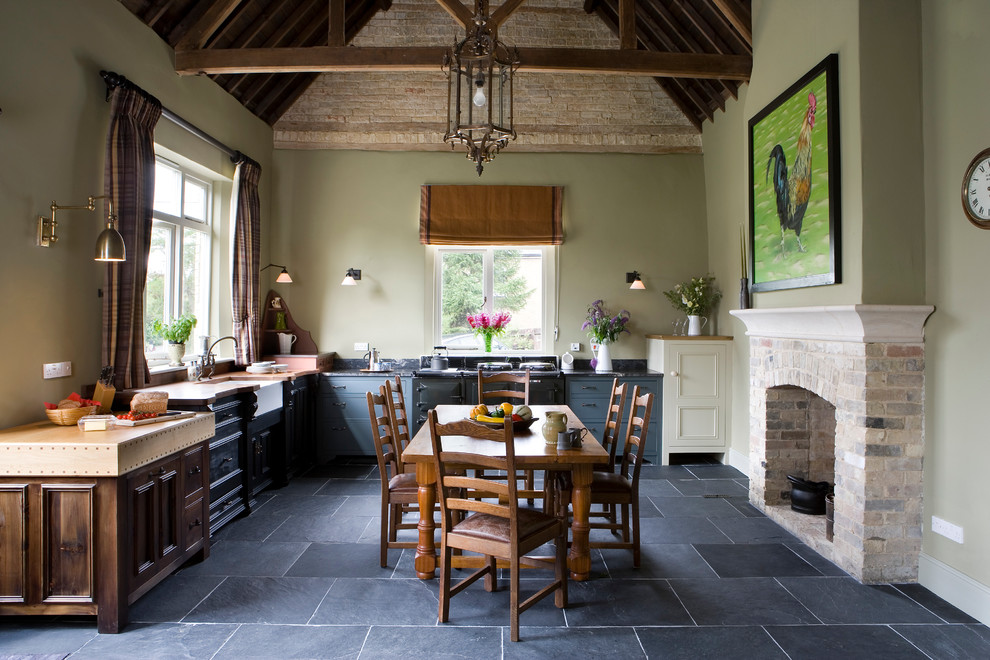 Large farmhouse l-shaped slate floor eat-in kitchen photo in Other with a farmhouse sink, recessed-panel cabinets, gray cabinets, no island and black appliances