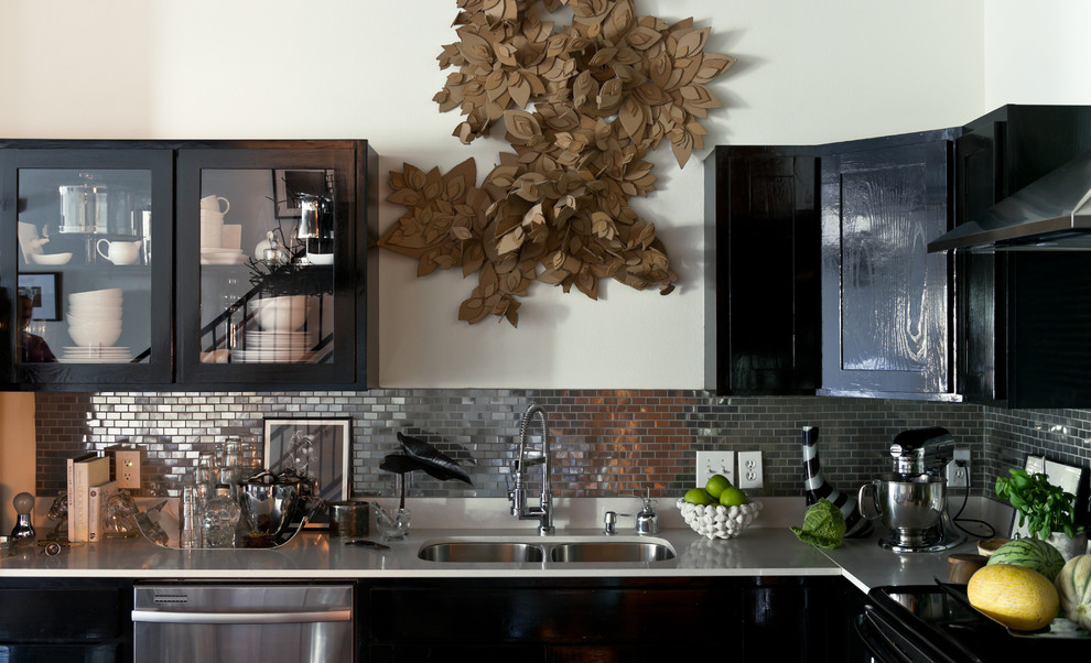Kitchen - contemporary kitchen idea in Dallas with glass-front cabinets, black cabinets, metal backsplash, stainless steel appliances, a double-bowl sink and metallic backsplash