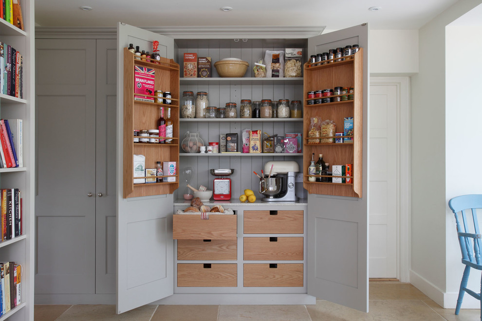 Country kitchen pantry photo in Surrey with gray cabinets
