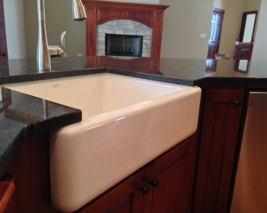 Red Cabinets, Granite Countertops, a Farmhouse Sink and Gray