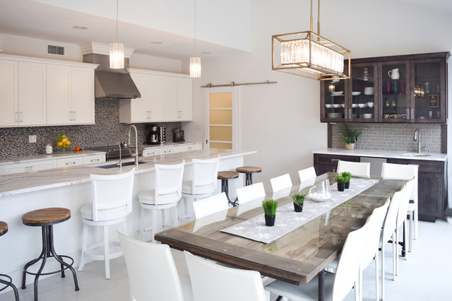 Eat-in kitchen - mid-sized transitional single-wall marble floor eat-in kitchen idea in New York with an undermount sink, shaker cabinets, white cabinets, quartz countertops, gray backsplash, glass tile backsplash, stainless steel appliances and an island