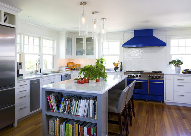 Kitchen - mid-sized beach style u-shaped medium tone wood floor and brown floor kitchen idea in Boston with glass-front cabinets, subway tile backsplash, colored appliances, an undermount sink, white cabinets, white backsplash and an island
