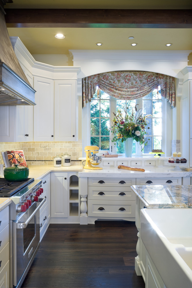 Elegant kitchen photo in Portland with stainless steel appliances and a farmhouse sink