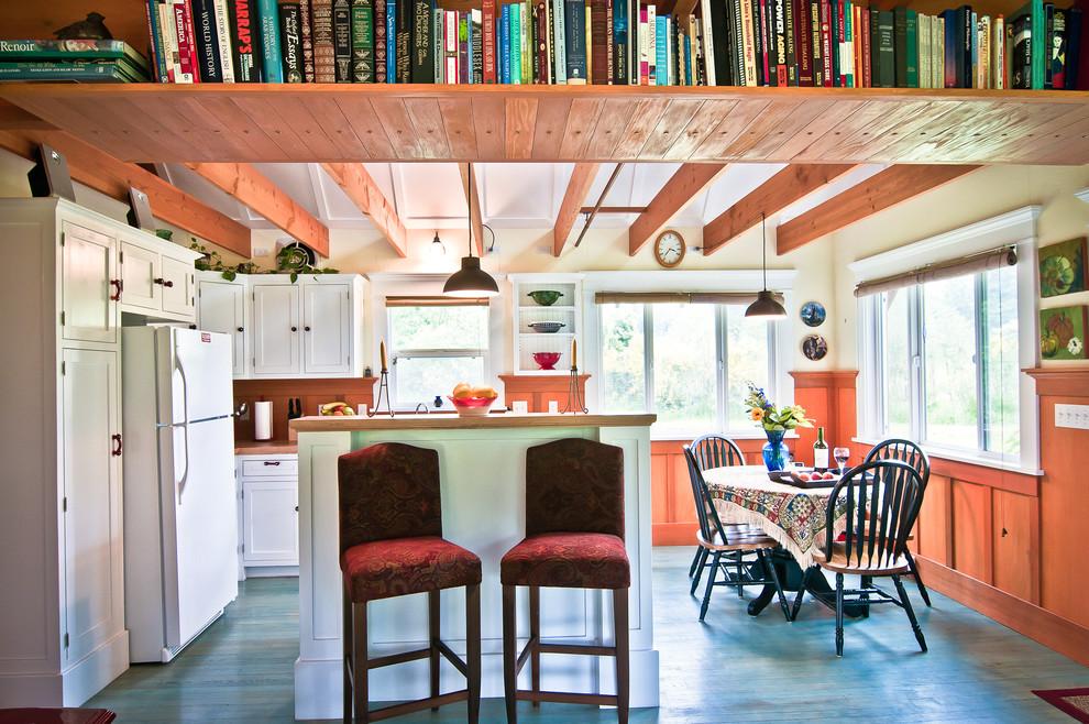 Inspiration for a rustic painted wood floor and blue floor eat-in kitchen remodel in Melbourne with shaker cabinets and white cabinets