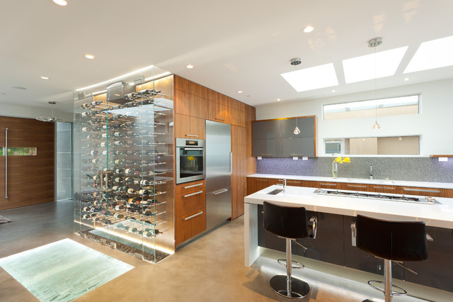 Example Of A Trendy Kitchen Design In Vancouver With Flat Panel Cabinets,  Gray Backsplash