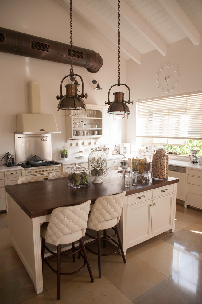 Inspiration for a transitional kitchen remodel in Tel Aviv with recessed-panel cabinets, beige cabinets, wood countertops, an island and white appliances