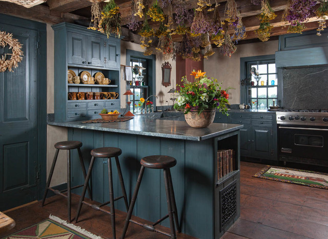 Farmhouse u-shaped kitchen photo in Boston with raised-panel cabinets, blue cabinets, a peninsula and stainless steel appliances