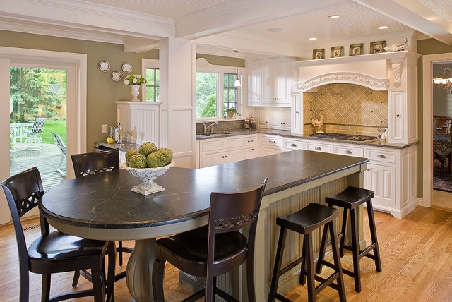 example of a mid sized classic l shaped light wood floor eat in - Round Kitchen Island