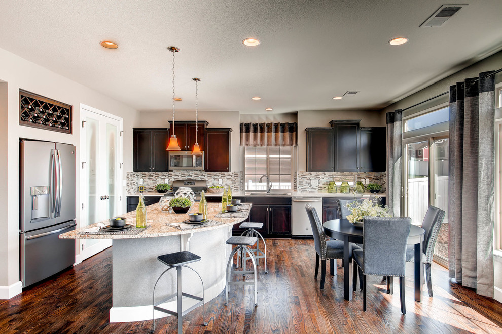 Inspiration for a transitional l-shaped dark wood floor eat-in kitchen remodel in Denver with an undermount sink, recessed-panel cabinets, dark wood cabinets, multicolored backsplash, mosaic tile backsplash, stainless steel appliances and an island