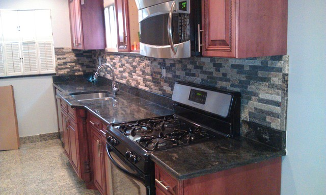 stone veneer in a mixed color blend installed as a kitchen backsplash