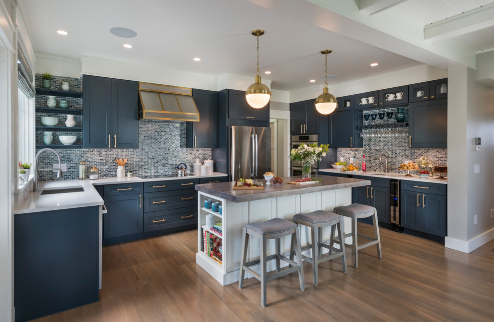 Eat-in kitchen - coastal u-shaped dark wood floor eat-in kitchen idea in Providence with an undermount sink, shaker cabinets, blue cabinets, blue backsplash, stainless steel appliances and an island