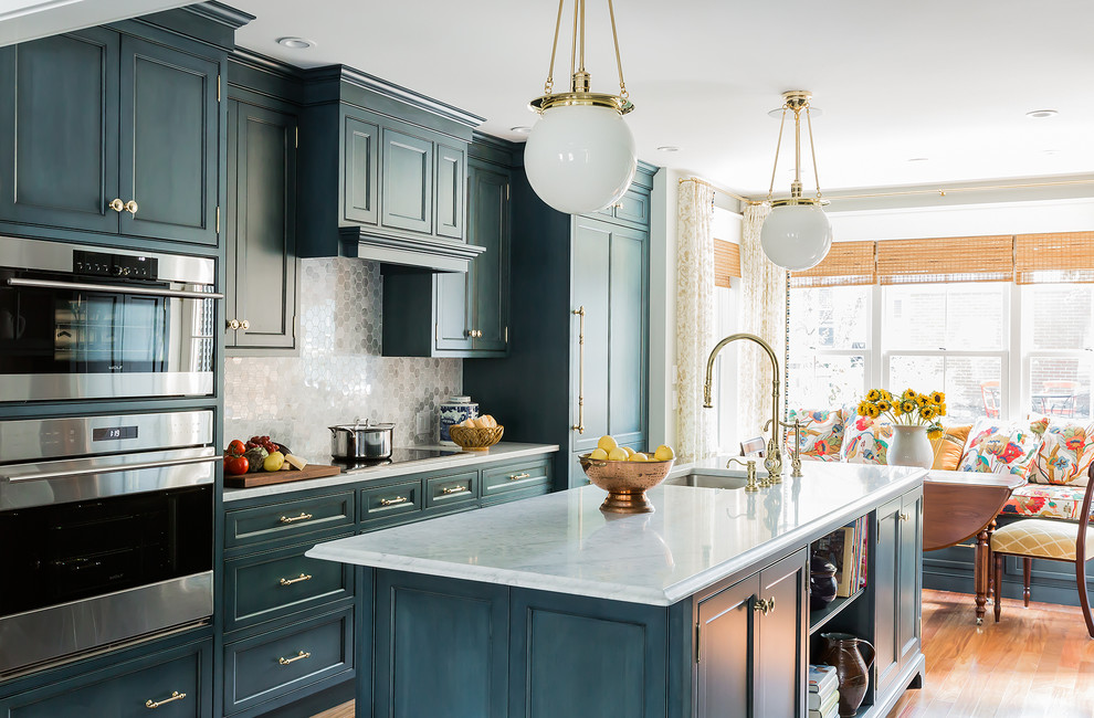 Eat-in kitchen - mid-sized traditional medium tone wood floor and brown floor eat-in kitchen idea in Boston with an undermount sink, beaded inset cabinets, blue cabinets, marble countertops, gray backsplash, stone tile backsplash, paneled appliances and an island