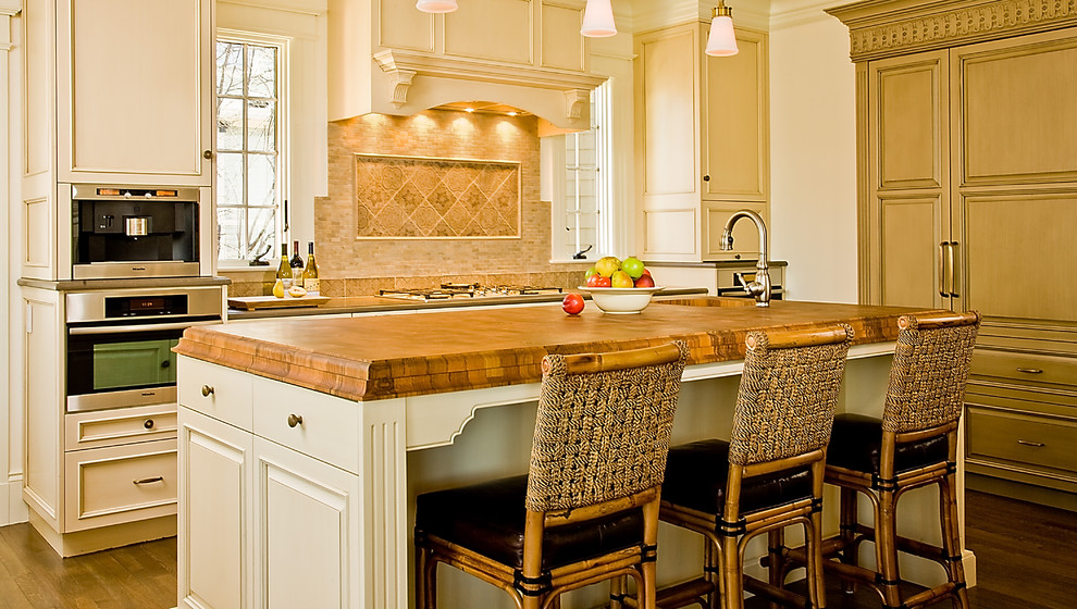 Inspiration for a timeless kitchen remodel in Boston with wood countertops and beige cabinets