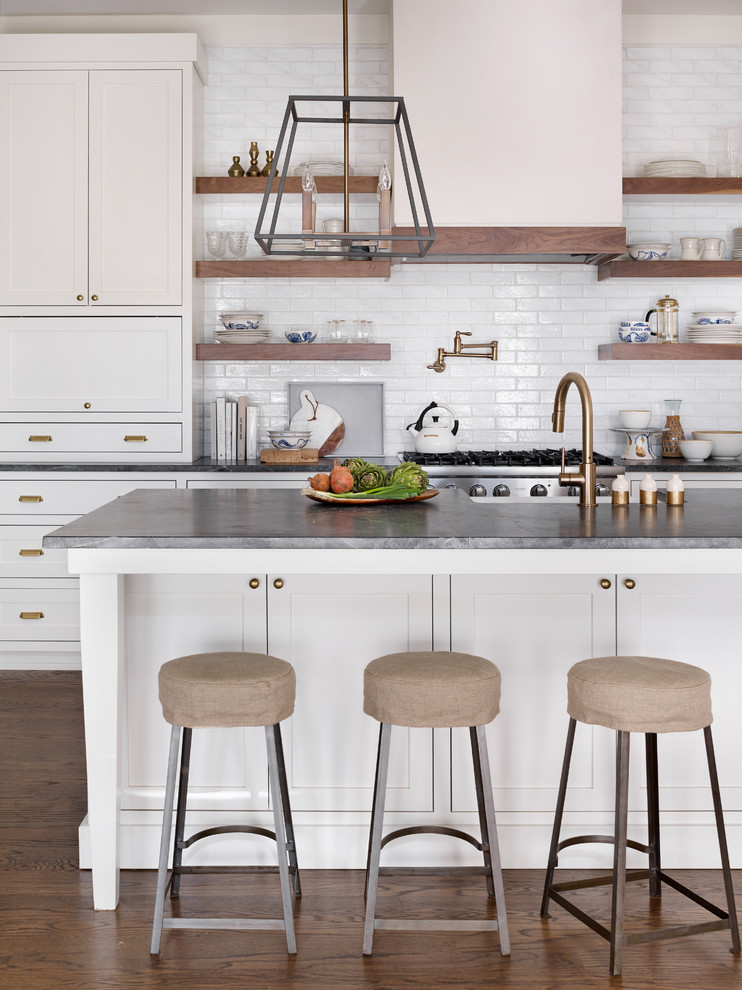 Kitchen - transitional dark wood floor kitchen idea in Atlanta with shaker cabinets, white cabinets, white backsplash, subway tile backsplash and an island