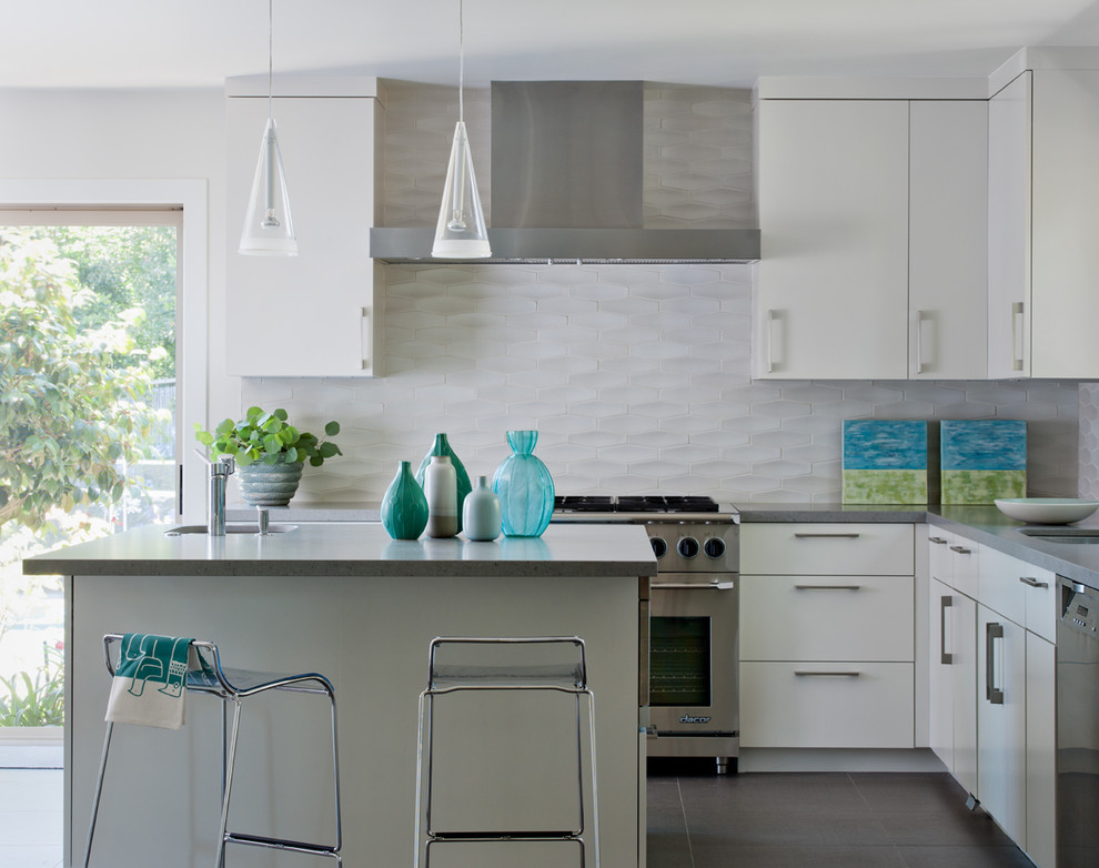 Inspiration for a transitional kitchen remodel in San Francisco with stainless steel appliances, flat-panel cabinets, white cabinets, quartz countertops, white backsplash and porcelain backsplash