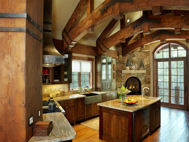 Timber frame home rustic kitchen by sitka log homes for Log home kitchen designs