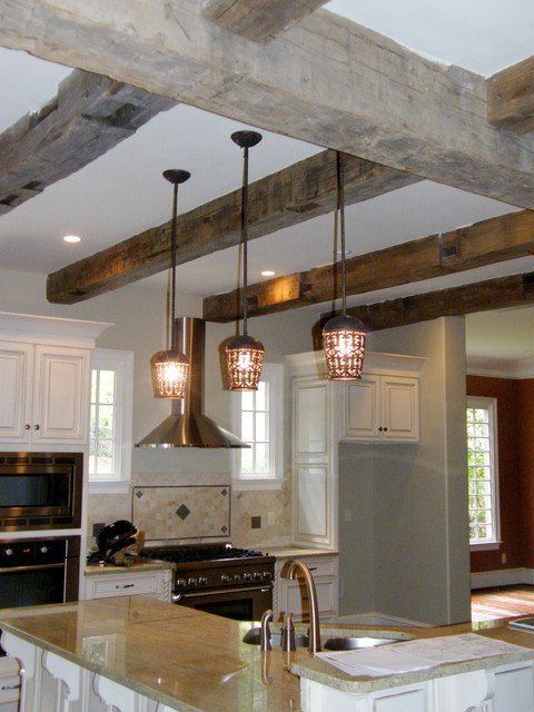 Timber frame kitchen design with reclaimed beams for Reclaimed house materials