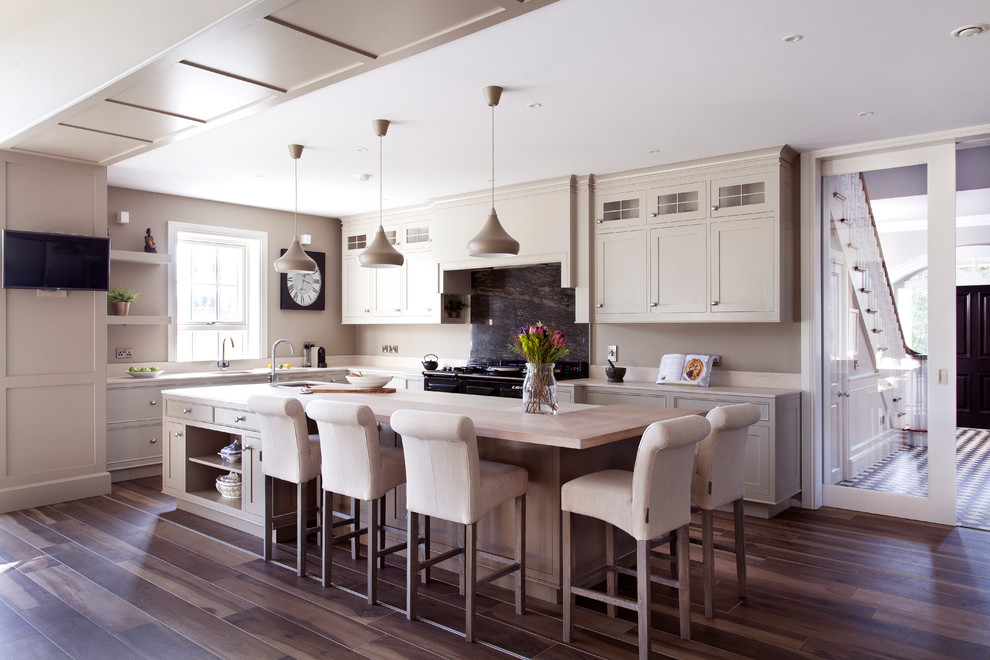 Inspiration for a huge transitional l-shaped eat-in kitchen remodel in Dublin with beaded inset cabinets, black backsplash, stone slab backsplash, stainless steel appliances and an island