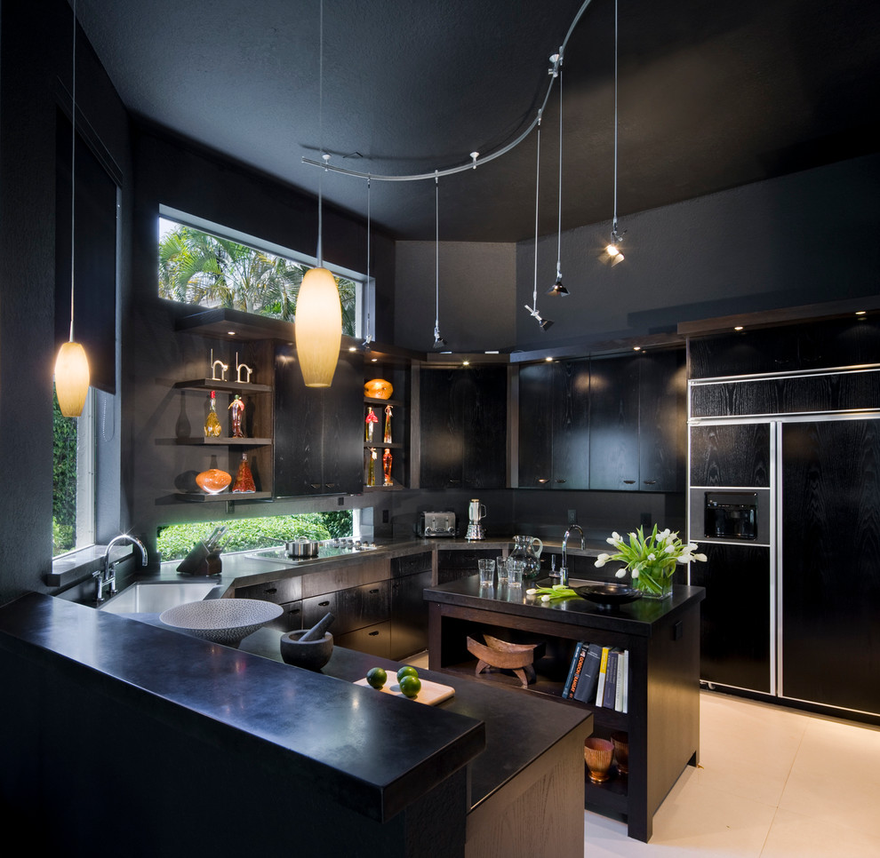 Example of a trendy kitchen design in Miami with flat-panel cabinets, black cabinets and paneled appliances