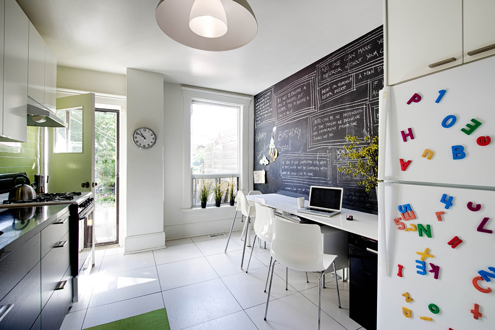 Inspiration for a mid-sized contemporary ceramic floor and white floor enclosed kitchen remodel in Toronto with flat-panel cabinets, green backsplash, subway tile backsplash, white appliances and quartz countertops