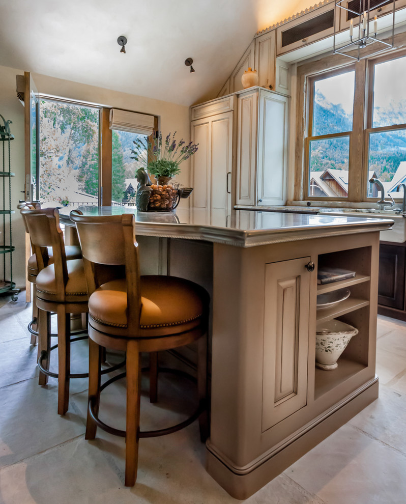 Example of a mid-sized classic l-shaped ceramic tile open concept kitchen design in Denver with a farmhouse sink, raised-panel cabinets, paneled appliances, an island, dark wood cabinets and granite countertops