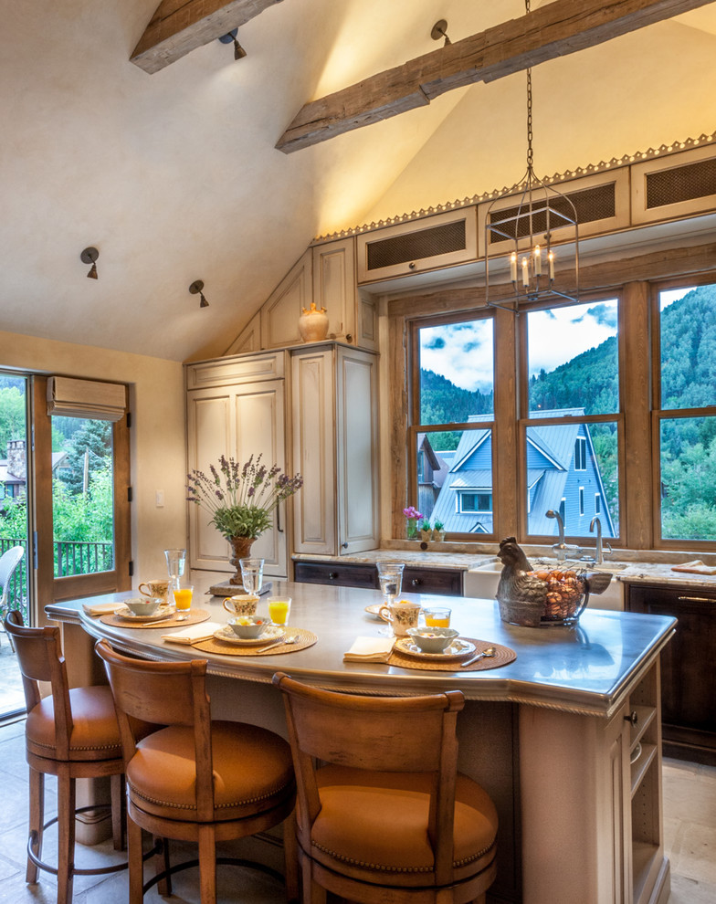 Example of a mid-sized classic l-shaped ceramic tile open concept kitchen design in Denver with raised-panel cabinets, paneled appliances, an island, a farmhouse sink, dark wood cabinets and granite countertops