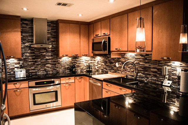 Maple kitchen cabinets with black absolute granite countertops on Granite Countertops With Maple Cabinets  id=94677