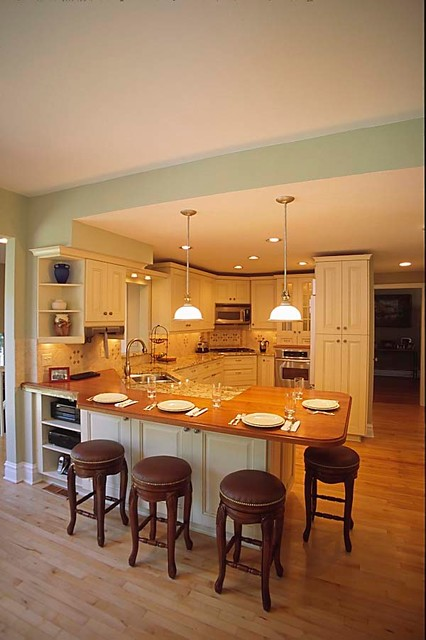 traditional cream kitchen with wood eating counter in