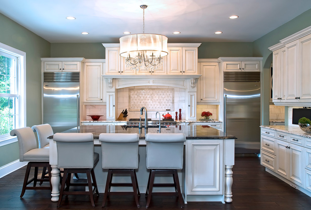 Kitchen - traditional kitchen idea in San Diego with granite countertops and stainless steel appliances