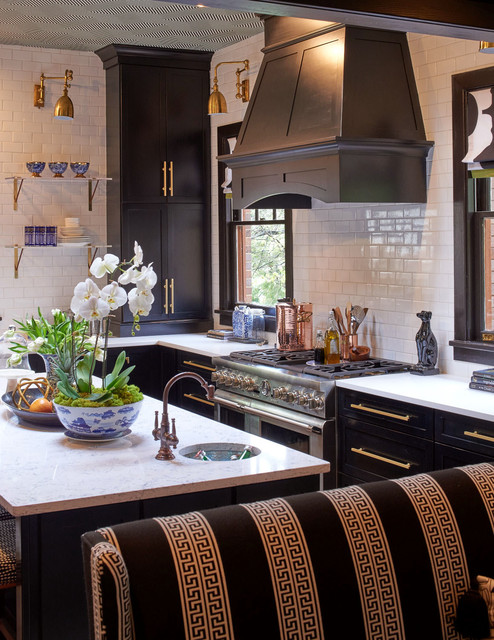 Transitional l-shaped eat-in kitchen photo in Raleigh with recessed-panel cabinets, black cabinets, quartz countertops, white backsplash, ceramic backsplash, stainless steel appliances and an island