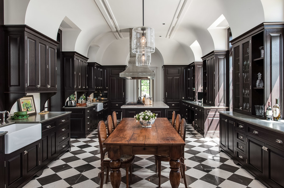 Eat-in kitchen - traditional u-shaped multicolored floor eat-in kitchen idea in Miami with a farmhouse sink, raised-panel cabinets and dark wood cabinets