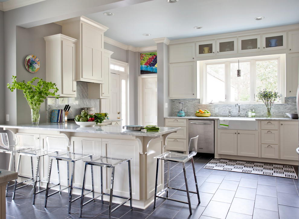 Inspiration for a timeless gray floor kitchen remodel in Other with stainless steel appliances and a farmhouse sink
