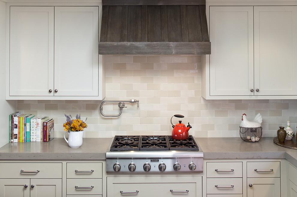 Inspiration for a timeless kitchen remodel in San Francisco with beige backsplash, subway tile backsplash and concrete countertops