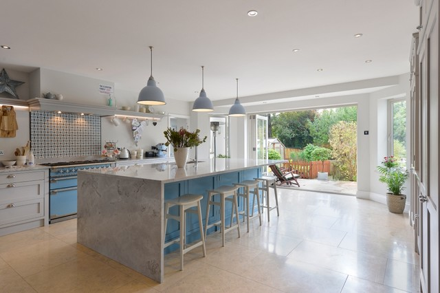 Kitchen created in unused space with bifold doors on to extended