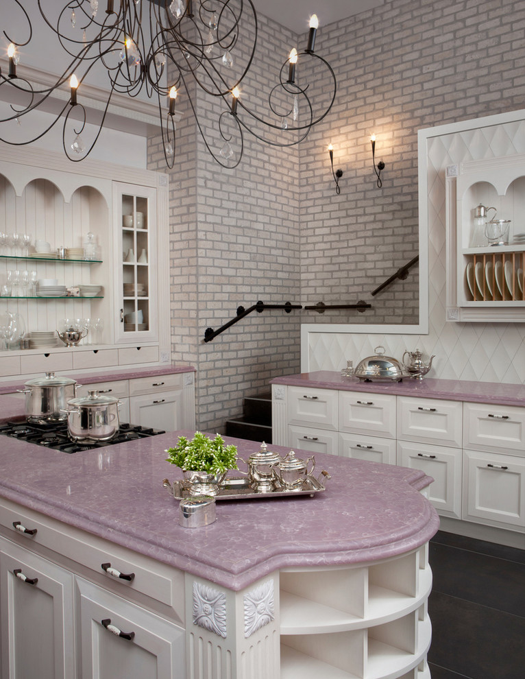 Kitchen - traditional kitchen idea in Los Angeles with recessed-panel cabinets, quartz countertops and purple countertops