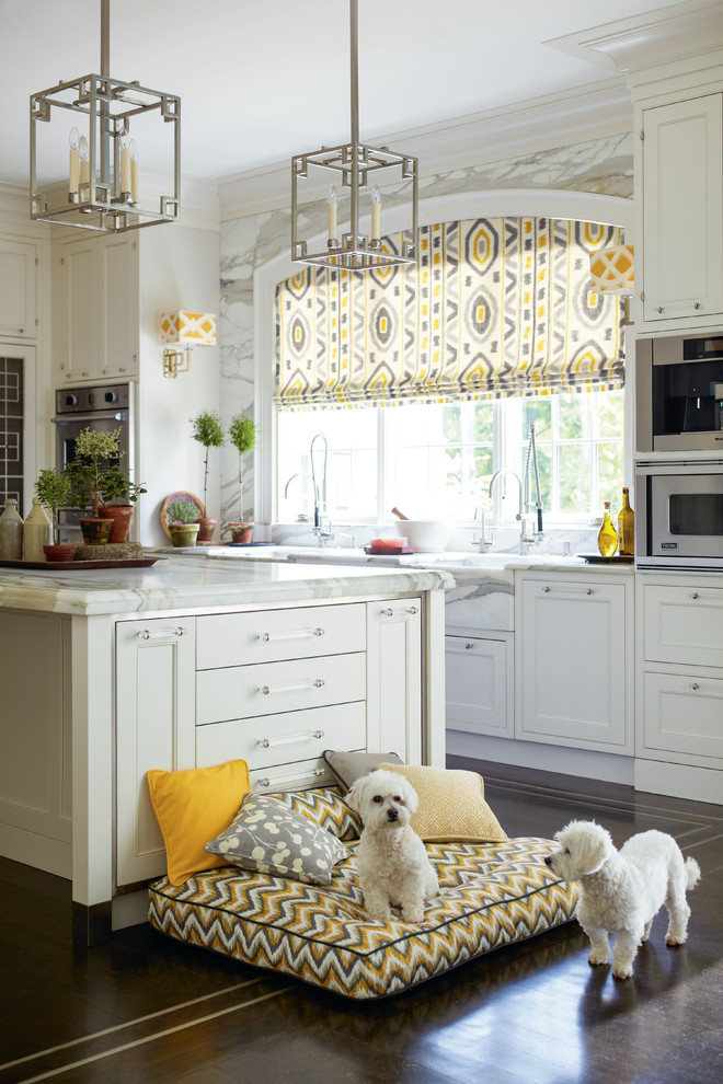 Kitchen - traditional dark wood floor kitchen idea in Philadelphia with white cabinets, white backsplash, stainless steel appliances and an island