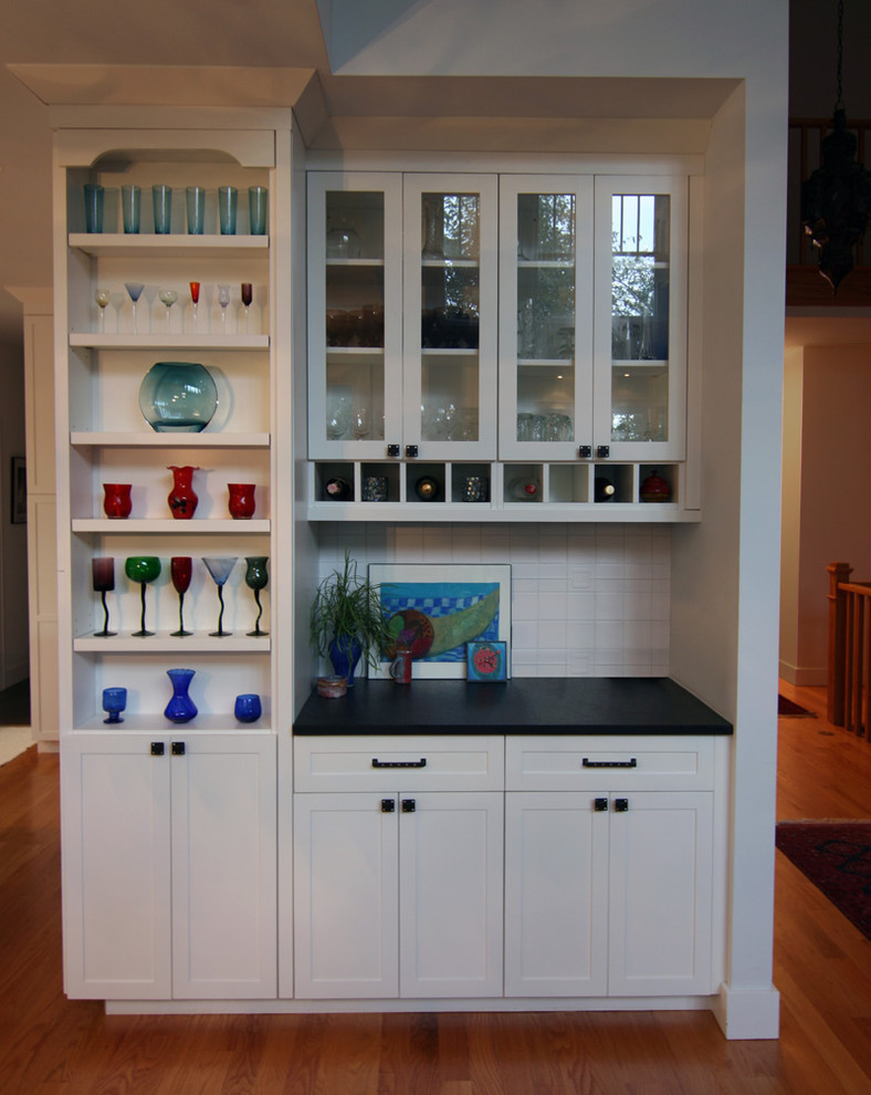 Kitchen - traditional kitchen idea in Detroit with glass-front cabinets, white cabinets and white backsplash