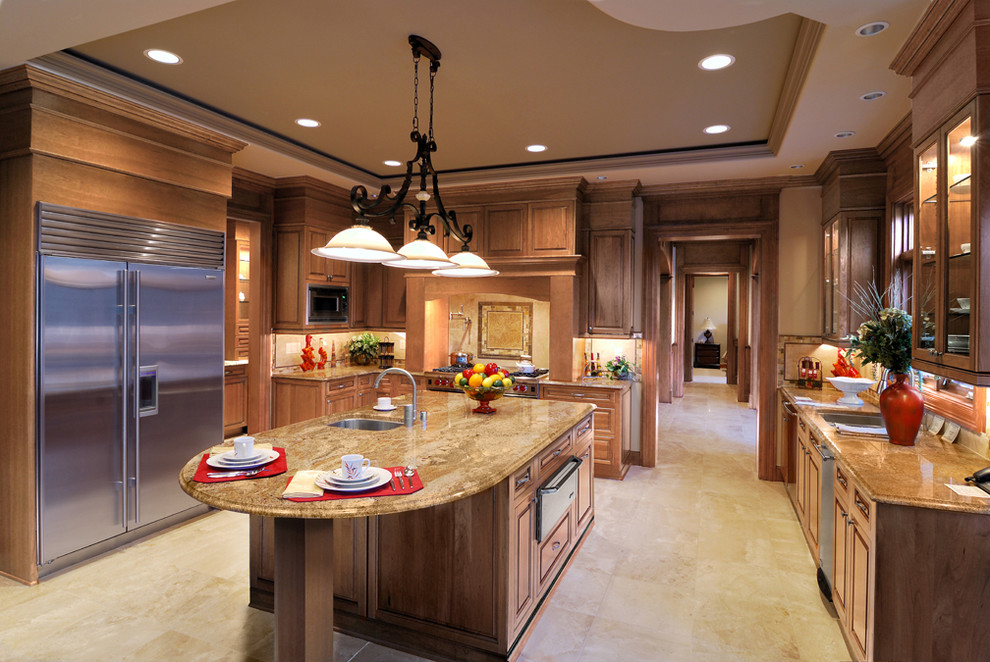 Example of a classic u-shaped kitchen design in Minneapolis with an undermount sink, raised-panel cabinets, medium tone wood cabinets, beige backsplash and stainless steel appliances