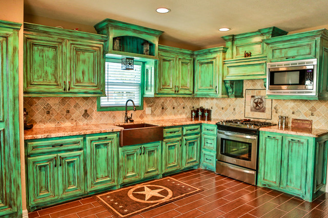 Kitchen - traditional kitchen idea in Houston with stainless steel appliances, distressed cabinets, a farmhouse sink and beige backsplash